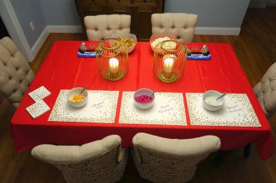 Photo of the dining room, decorated with red and gold accents
