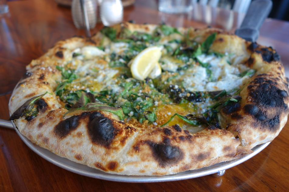 Area Four spinach and garlic pizza