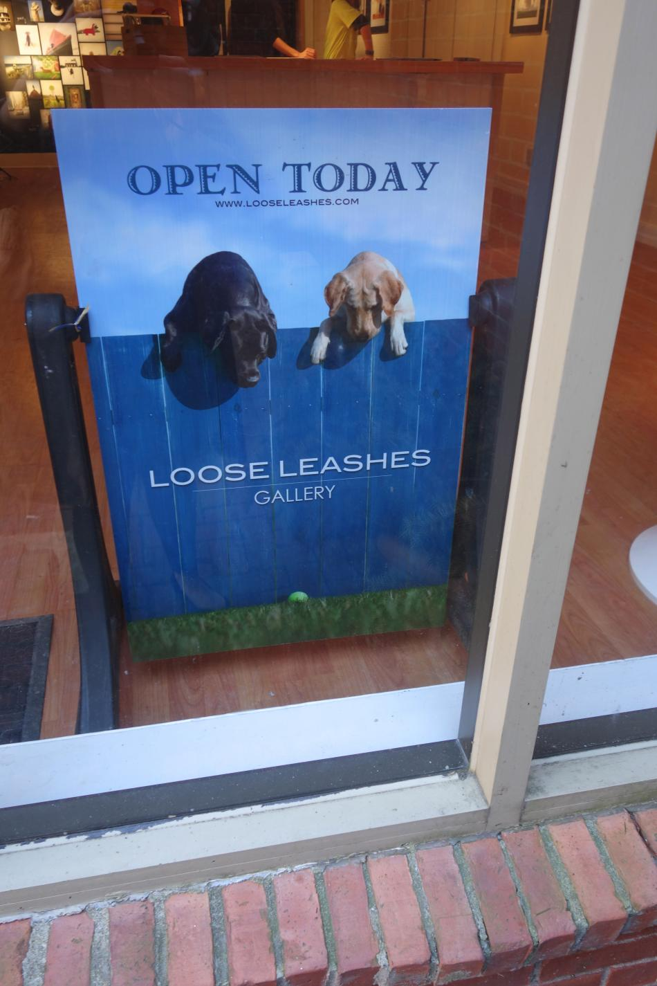 Loose Leashes Sign